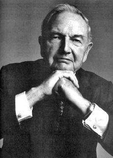 David Rockefeller in an unnatural cabalistic pose.