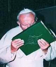 """Pope John Paul proving that the pope is in-fact not infallible by kissing the Koran, the """"holy"""" book of Muslims that blasphemes the name of our Lord Jesus Christ."""